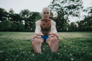 Bikram Yoga Instructor Dan Markowitz in Stretching Pose